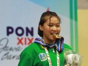 Heli Arfi Lindah, peraih emas di kelas 61-2 - 66kg putri